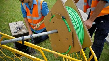 Rolling out fibre optic cable.