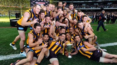 Hawthorn celebrates winning the grand final.