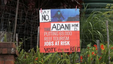 A sign protesting against the Adani mine in South Brisbane.