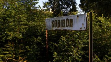 A rusty road sign is seen outside the perimeter of the Nazi's Sobibor death camp in Poland.