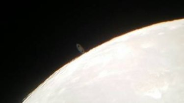 Occultation  of Saturn, captured with a camera phone on May 14.