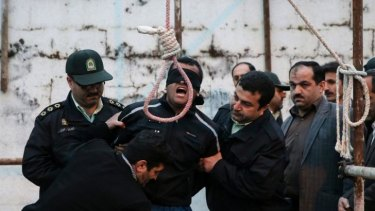 Balal, who killed Abdolah Hosseinzadeh in a street fight with a knife in 2007, is brought to the gallows during his execution ceremony.