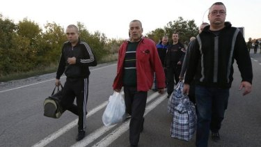 Motley crew: Pro-Russian prisoners-of-war walk along a road as they wait to be exchanged near Donetsk.