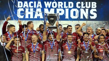 World champions: Wigan celebrate the famous victory over the Cronulla Sharks in February.