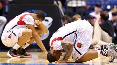 Shocked ... Wayne Blackshear, left, and Chane Behanan react after Kevin Ware was injured.
