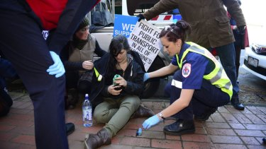 Injured ... East-west link protester Kat Galea after a clash with police outside the John Holland office in Collingwood.
