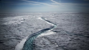 Meltwater flows along a glacial river on the Greenland ice sheet last July.