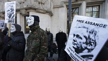 Julian Assange's supporters brave the cold outside the Supreme Court in London during his extradition hearing.