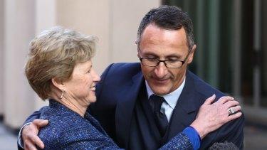 Handover: Former Greens leader Senator Christine Milne embraces her successor, Senator Richard Di Natale.