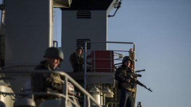Ukrainian seamen stand guard on the Ukrainian navy ship Slavutich in the harbour at Sevastopol.