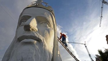 Spectacular... workers finish the head of Swiebodzin's Christ statue, due for completion next month.