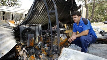Aftermath: Shane Vichie inspects his damaged sheds in Salt Ash.