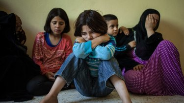 Jouri weeps as her aunt recounts their family's journey after they were forced to flee their home in Syria.