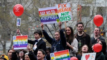 Supporters of same-sex marriage rally in Melbourne yesterday.