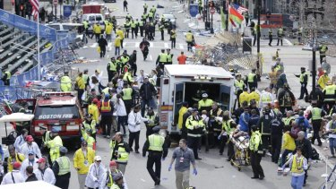 Chaotic scenes as authorities tend to the injured in Boston, where two mystery explosions went off at the end of the Boston Marathon.