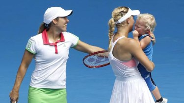 Cruz is carried off court by Denmark's Caroline Wozniacki (right) as Belgium's Justine Henin looks on.