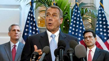 House Speaker John Boehner speaks to the media following a House Republican caucus meeting at the US Capitol.