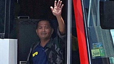 Rolando Mendoza, armed with a high-powered assault rifle,  waves from the bus he held Hong Kong tourists on before the bloodshed began.