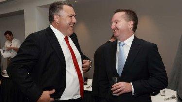 Treasurer Joe Hockey and former treasurer Chris Bowen.