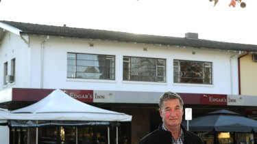 Jeff Darwin in 2015 outside his Ainslie shops building. The rood space in the flat above Edgar's Inn contains loose-fill Fluffy asbestos insulation.