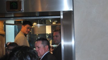 Crowded lift...life can be pretty squashy for Chinese basketball star Yao Ming.
