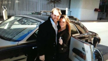 On her mum's side ... Ginia Rinehart with her boyfriend in front of her $1.2 million car.