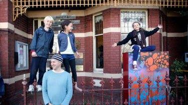 Principal Tim Berryman with Ted Wearn-Jarvis, Ella Berryman and Kate Jessop.