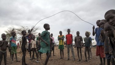A file photo taken on April 2, 2014 shows children jumping rope in the Kule refugee camp near the Pagak Border Entry point in the Gambela Region of Ethiopia.