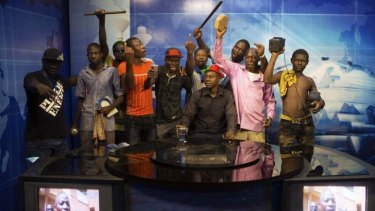 The revolution will be televised: Anti-government protesters take over state TV.