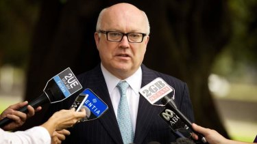 Forced to soften original plans: George Brandis.