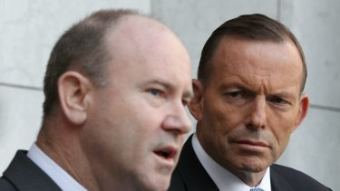 Greg Moriarty, Commonwealth Counter-Terrorism Co-ordinator, and Prime Minister Tony Abbott during a joint press conference at Parliament House in Canberra on Monday.