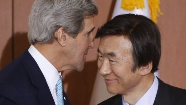 Whispers: US Secretary of State John Kerry speaks privately with South Korean Foreign Minister Yun Byung-se. At other times, Secretary Kerry and his department are counting on public broadcasts through social media.