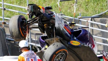 Daniel Ricciardo's Red Bull Racing car is removed from the track after his mishap in practice.