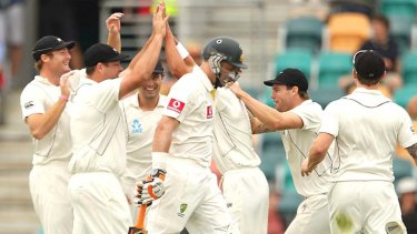 Australia's Mike Hussey departs for 15 after playing on from a Trent Boult delivery.