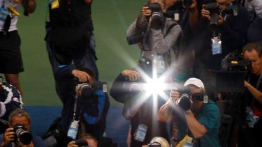 Flashes of brilliance ... Sam Stosur holds up the cup.