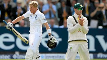 Michael Clarke can only appalud as Joe Root celebrates his century.