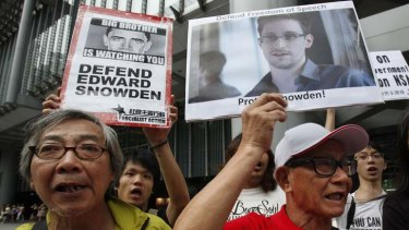 Moscow bound: Supporters of Edward Snowden march to the US Consulate in Hong Kong.