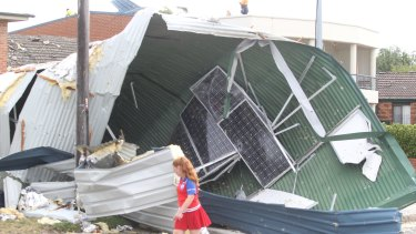 A girl surveys the damage in a residential street after a tornado hit Kurnell in December.