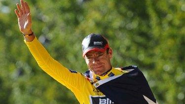 Cadel Evans celebrates on the podium after he won the 2011 Tour de France.