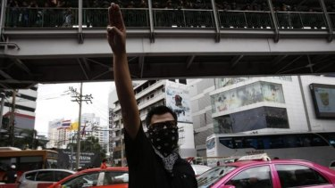 Gratitude, admiration and goodbye: a protester gives the three-finger salute during a demonstration outside a Bangkok shopping mall.