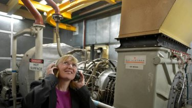 La Trobe University pro vice-chancellor Carol Adams with the gas turbine generator that produces much of the university's power.