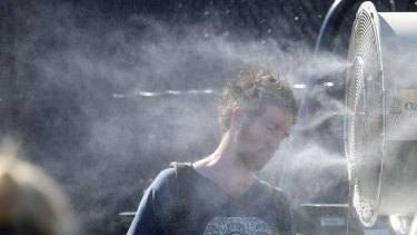 A tennis fan does his best to keep cool on day four of the Australian Open in Melbourne, this week.