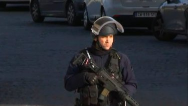 A security official stands guard outside the Louvre Museum in Paris.