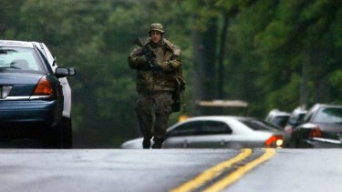 A member of the Pennsylvania State Trooper's tactical response unit near the scene where a trooper was killed.