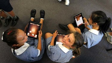 Chalking up another learning experience ... Isabella Sully, Charlotte Prichard and Maxine Kok, pupils of Neutral Bay Public, are enthusiastic about their iPads.