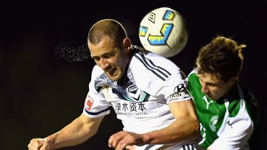 Melbourne Victory's Carl Valeri heads the ball during the FFA Cup quarter-final match against Bentleigh Greens.