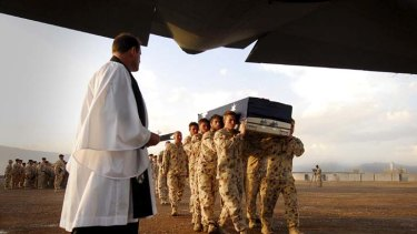 """""""A little better is everything to Afghans"""" - Veteran James Brown. Above, the Bearer Party carry the casket of Corporal Mathew Hopkins who died while conducting offensive operations in Oruzgan Province, southern Afghanistan."""