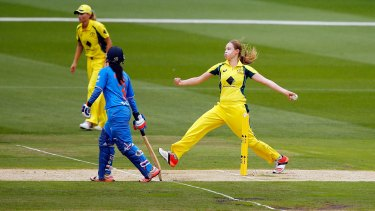 Keeping pace: Lauren Cheatle bowls during the match against India.
