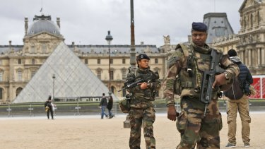 Soldiers patrol in the courtyard of the Louvre.