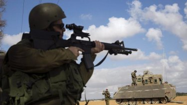 An Israeli soldier looks through the sight of his weapon outside the southern Gaza Strip on Thursday.